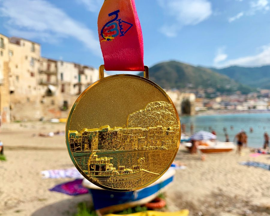 Half marathon medal in front of a beach